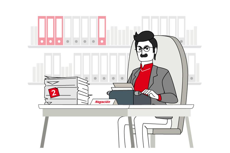 """ilustración número 2 de """"Las Fases del Cambio. Negación. Se ve a un hombre sentado ante una mesa, con una pila de papeles a su derecha y utilizando una máquina de escribir antigua."""